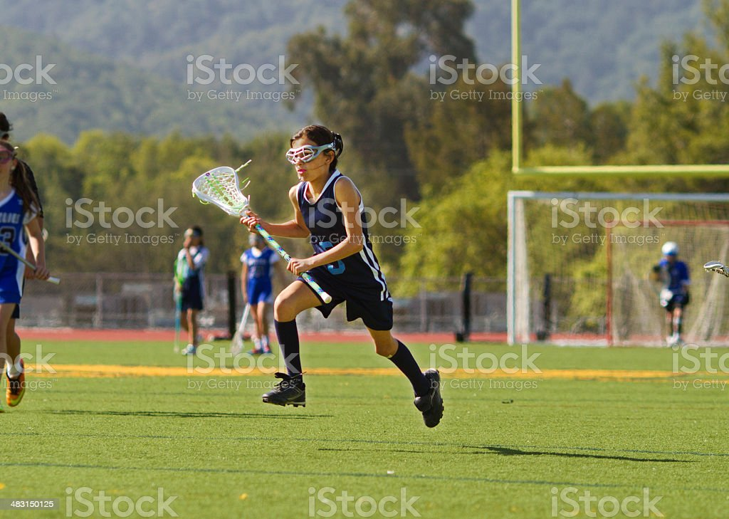 Girl Playing Lacrosse Mid Air stock photo