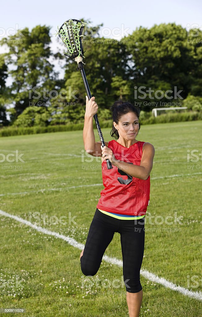 Girl playing lacrosse royalty-free stock photo