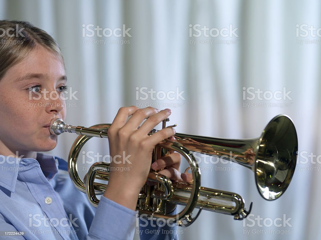 Girl playing musical instrument royalty-free stock photo