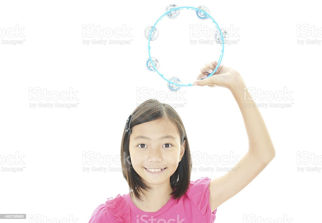 Girl playing musical toys stock photo