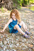 Girl Playing On Bank Of Mississippi River