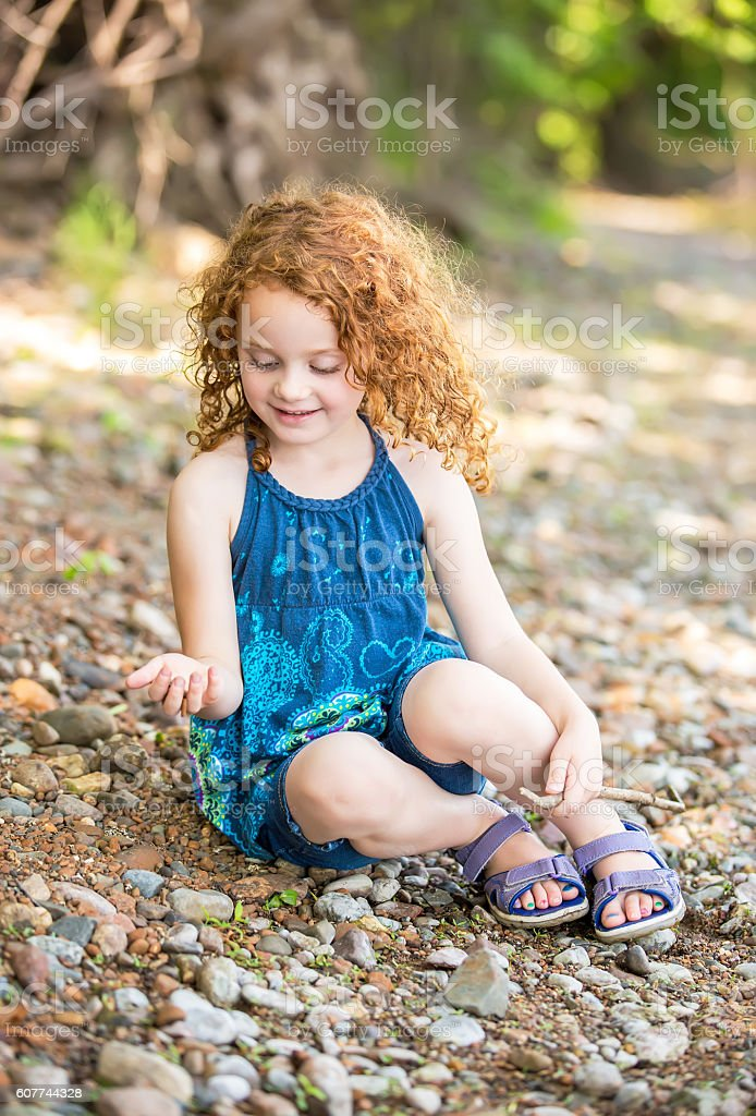 Girl Playing On Bank Of Mississippi River stock photo