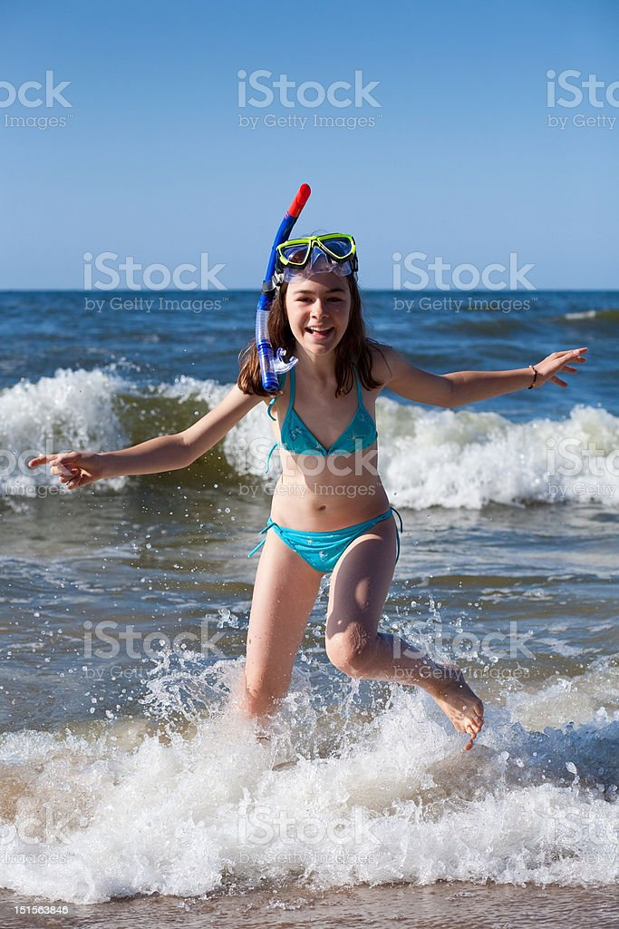 Girl playing on beach royalty-free stock photo