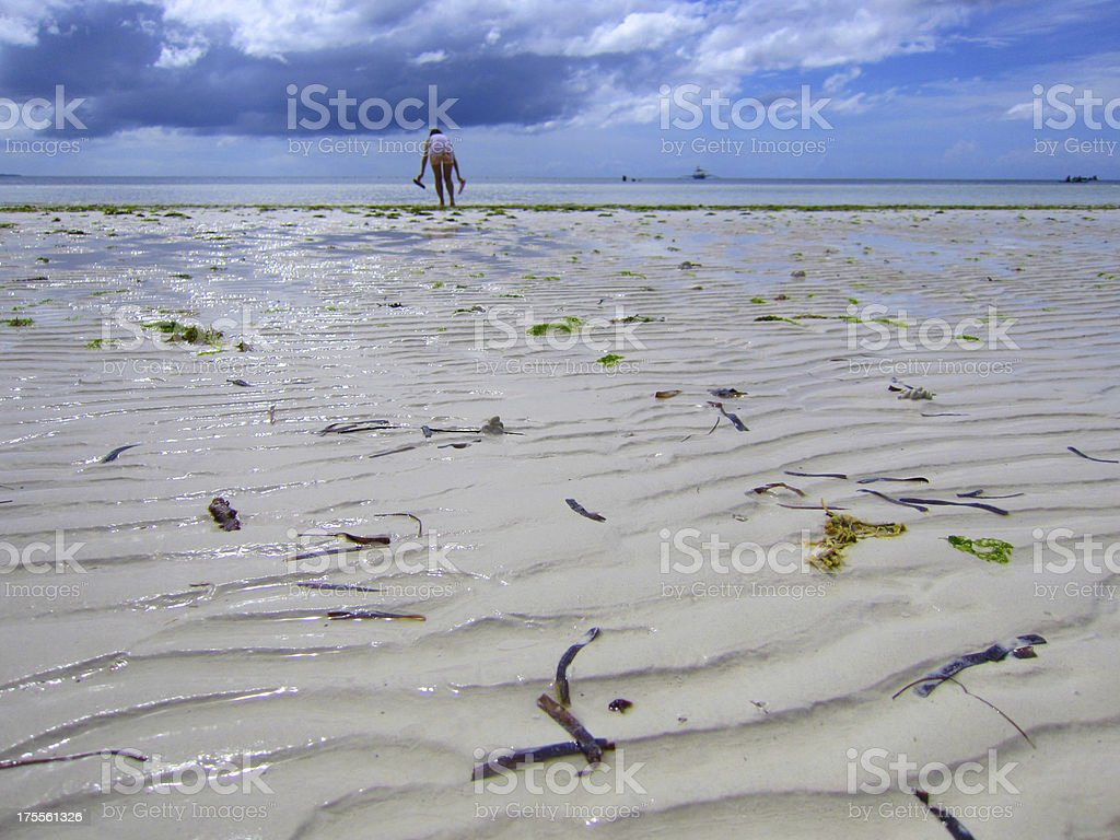 Girl Playing on Low Tide of Bohol Beach royalty-free stock photo