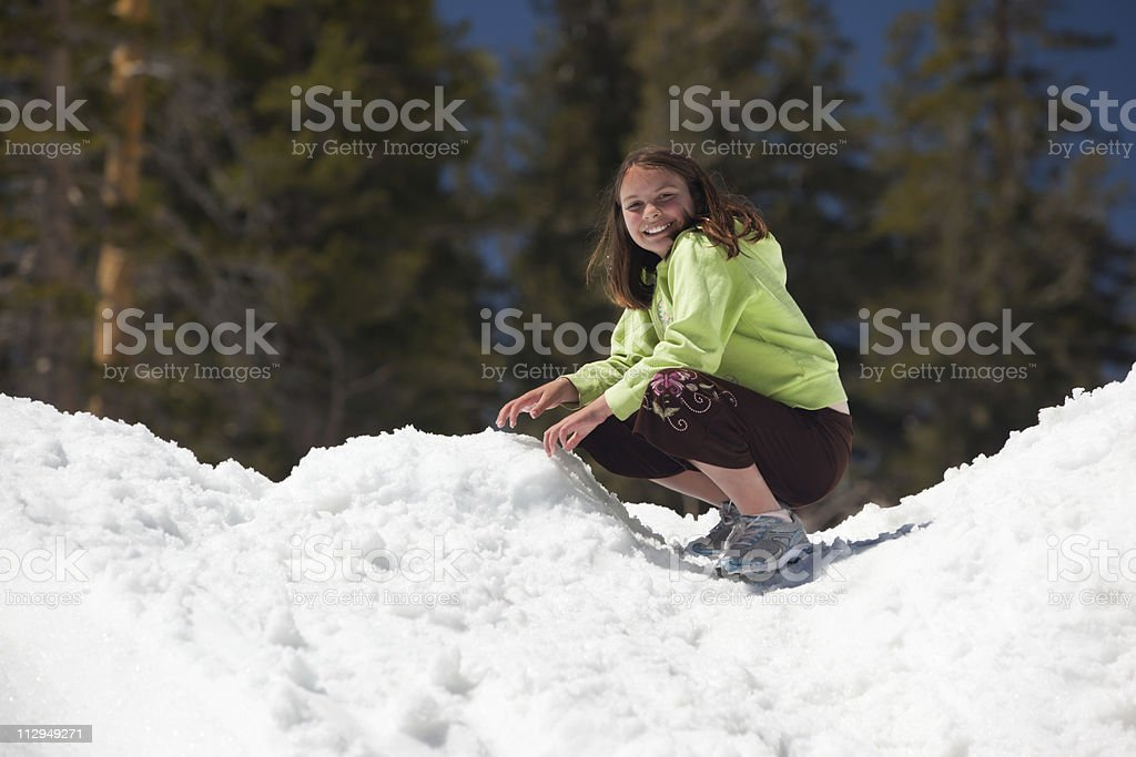 Girl playing on snowy hill royalty-free stock photo