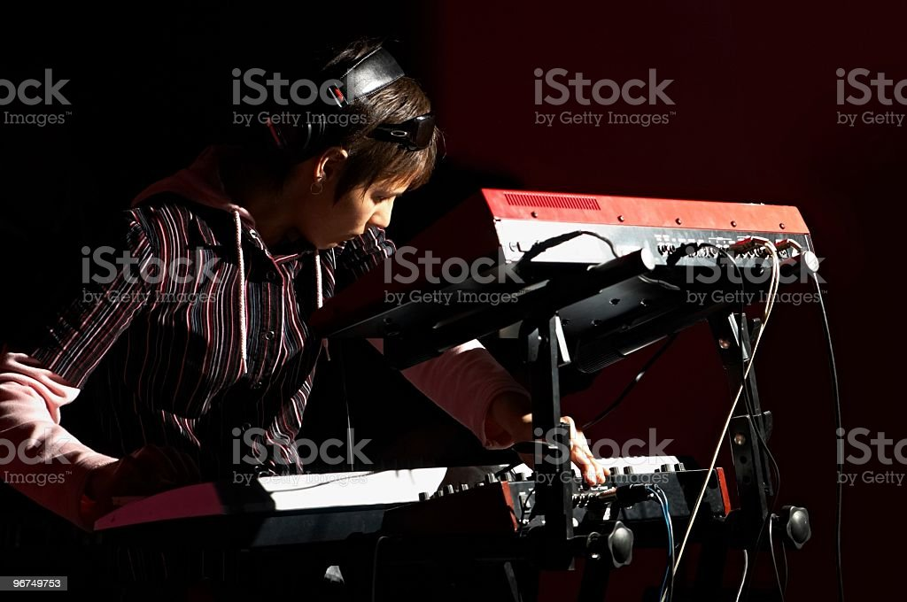 girl playing on synthesizer royalty-free stock photo