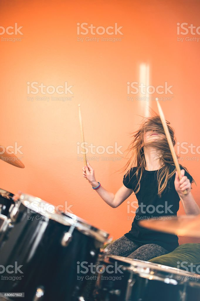 Girl Playing Rock and Roll Drums stock photo