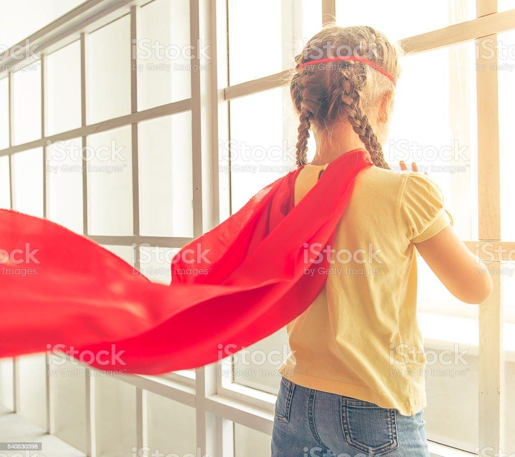 Girl playing superhero stock photo