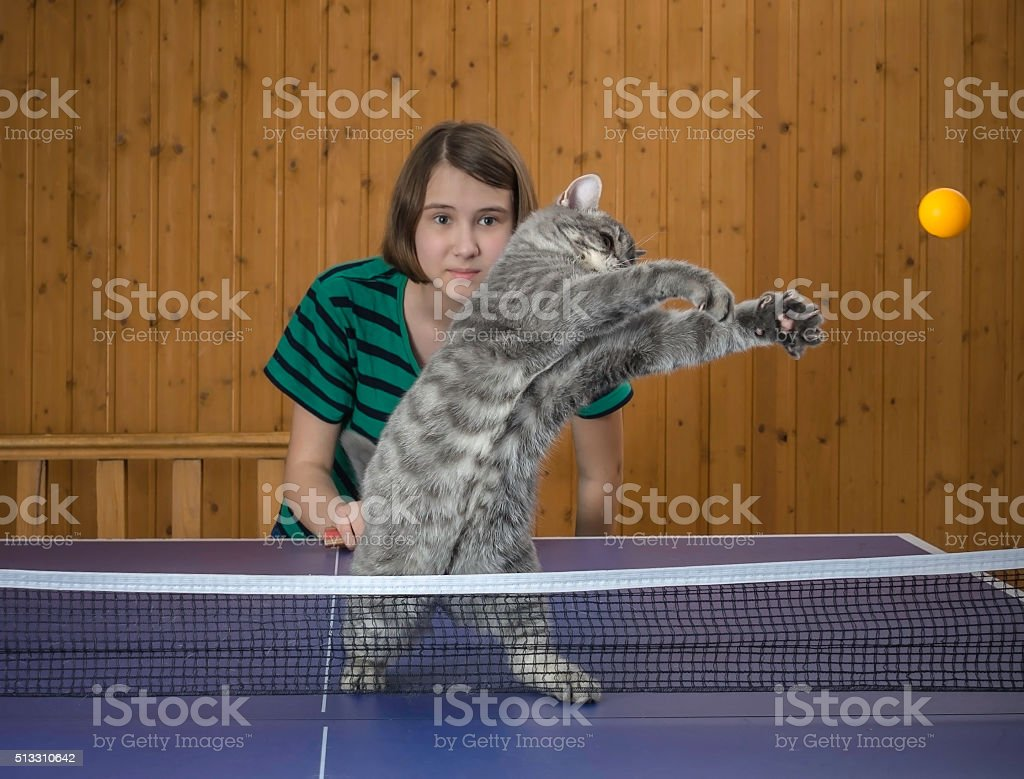 Girl playing table tennis stock photo