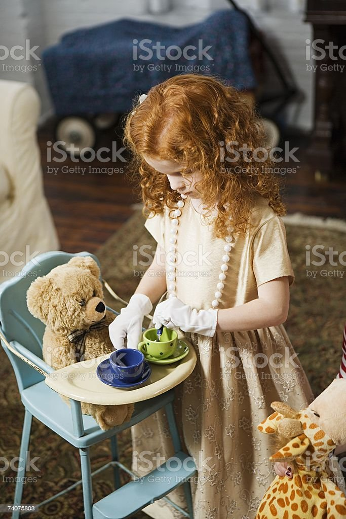 Girl playing tea party royalty-free stock photo