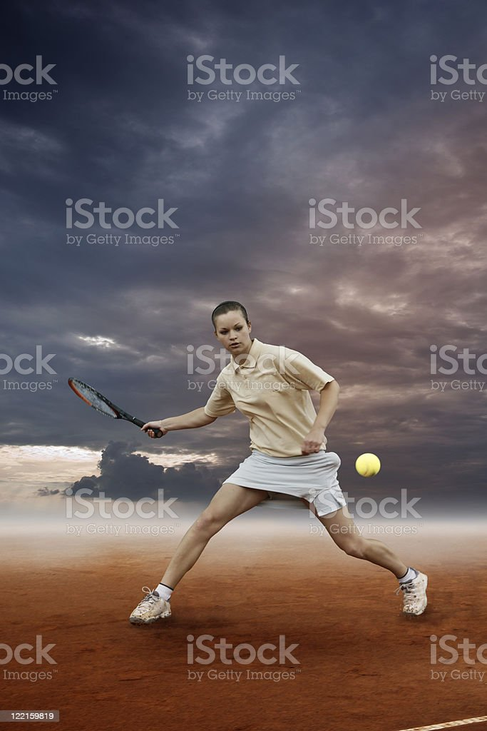 Girl playing tennis in dramatic atmosphere stock photo