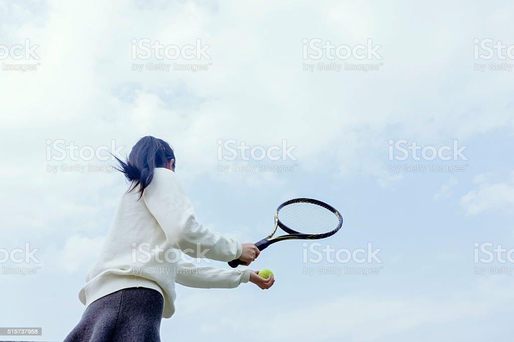 Girl playing tennis stock photo
