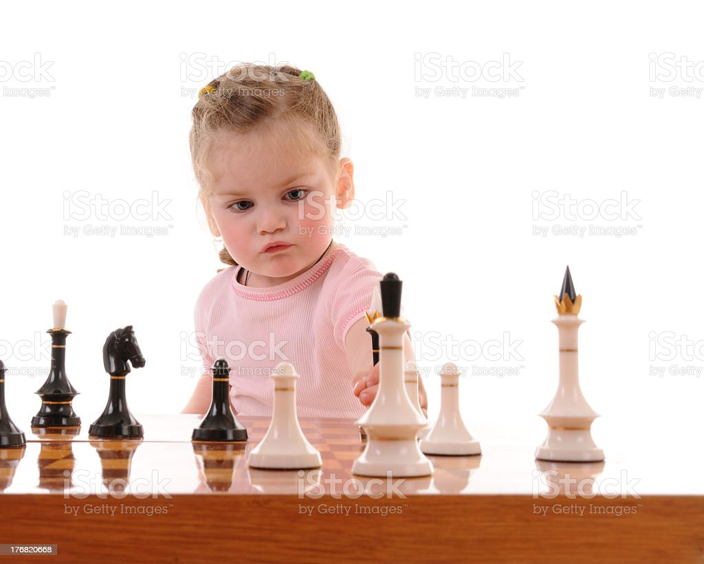Girl playing the chess royalty-free stock photo