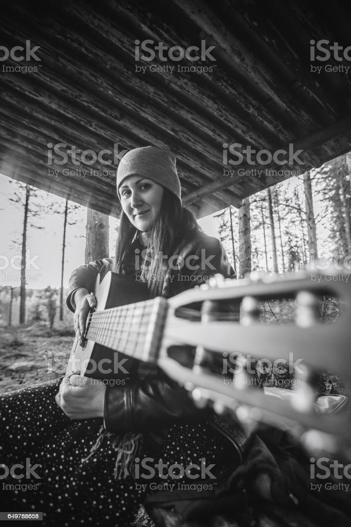 Girl Playing the Guitar stock photo