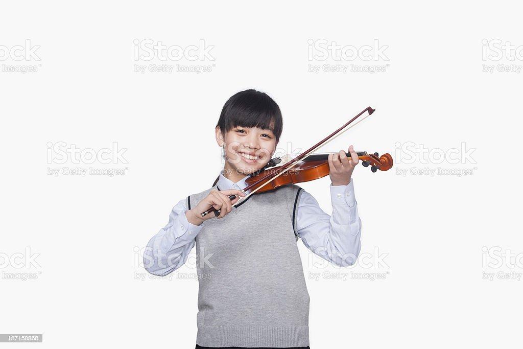 Girl playing the violin stock photo