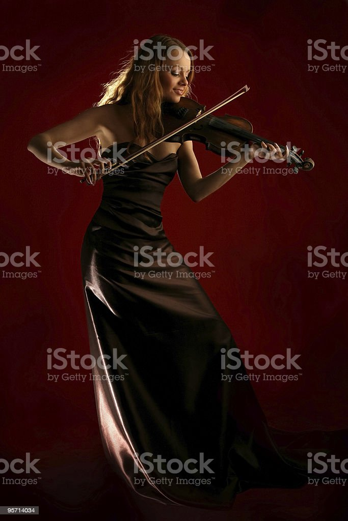 girl playing the violin stock photo