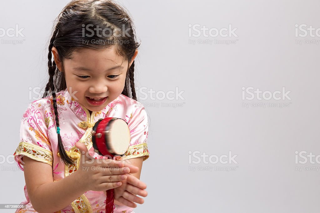 Girl Playing Toy Drum Background / Girl Playing Toy Drum stock photo