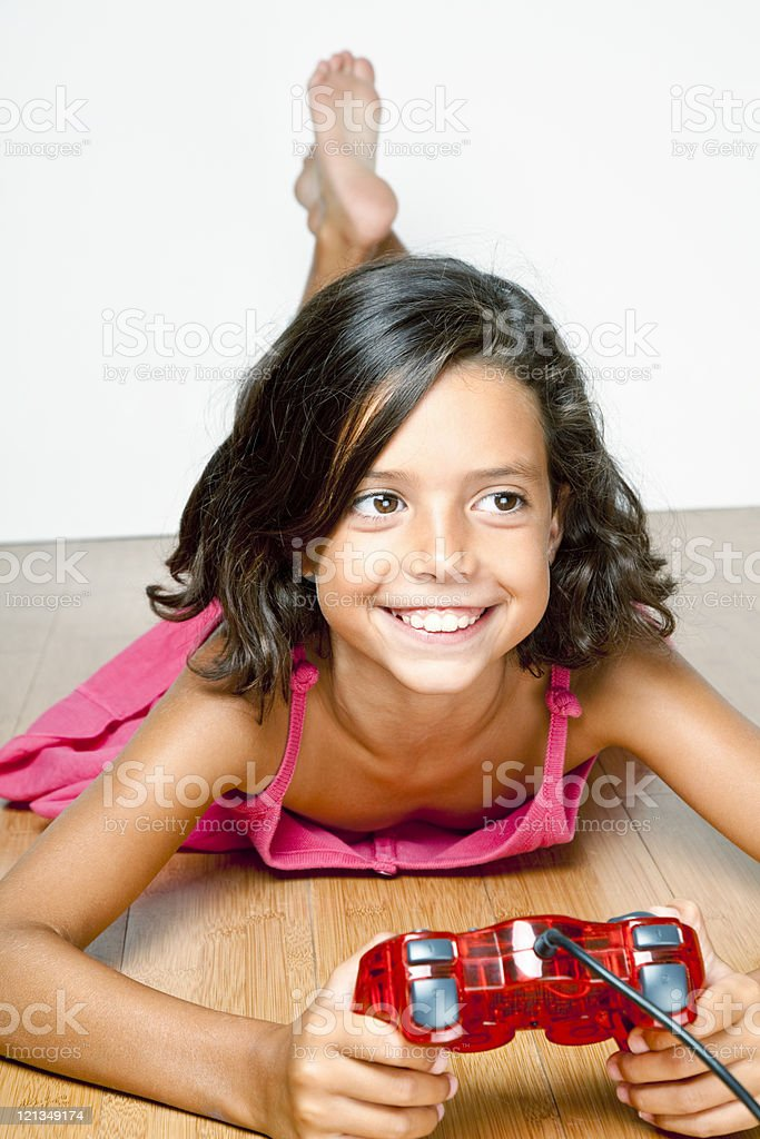 Girl playing video games royalty-free stock photo