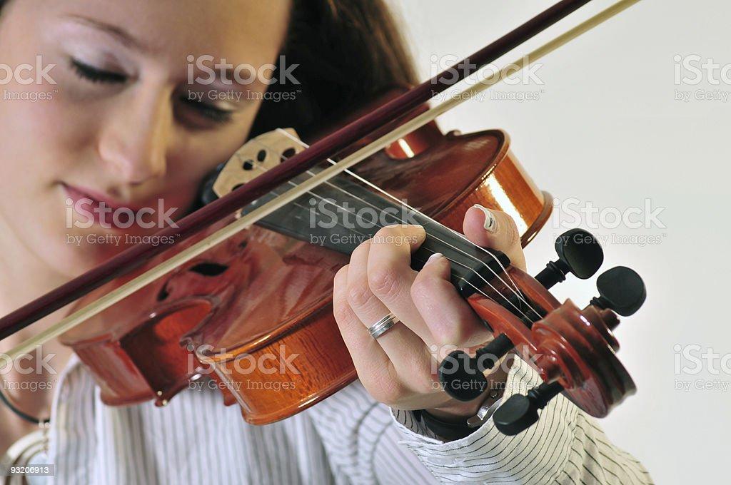 Girl playing violine stock photo