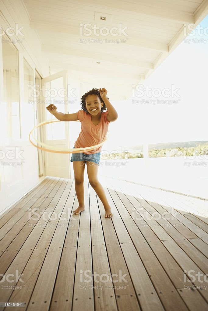 Girl playing with a hula hoop royalty-free stock photo