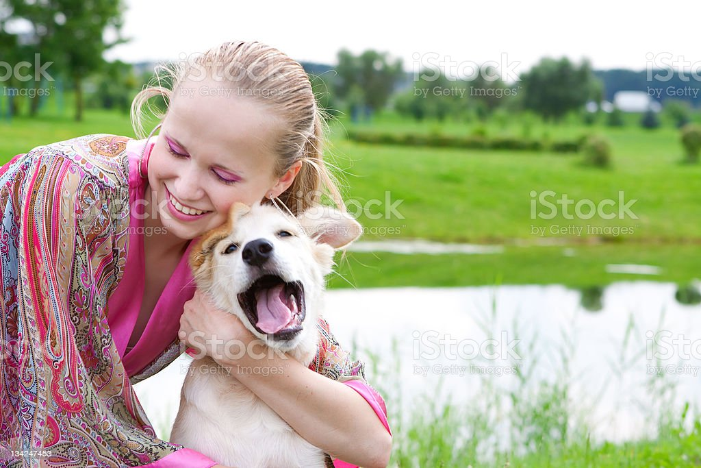 girl playing with a puppy, summer day royalty-free stock photo