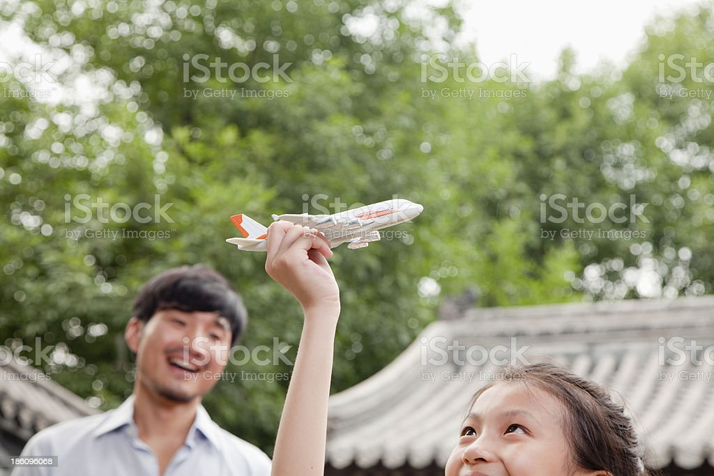 Girl Playing with Airplane royalty-free stock photo