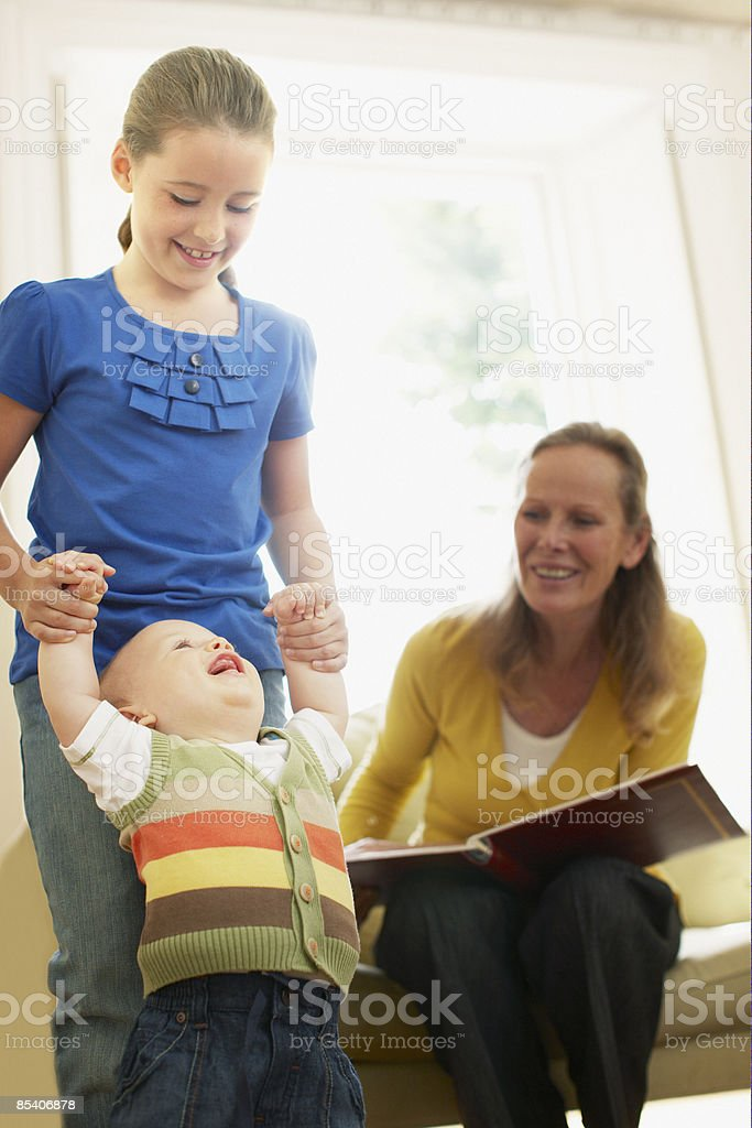 Girl playing with baby brother royalty-free stock photo
