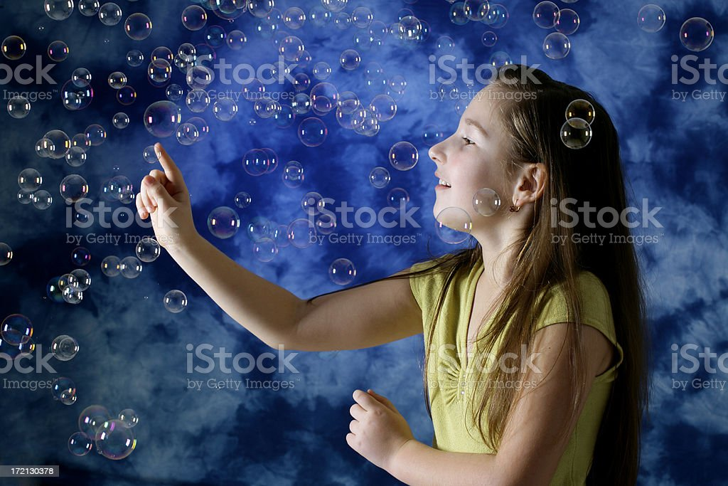 Girl playing with bubbles royalty-free stock photo