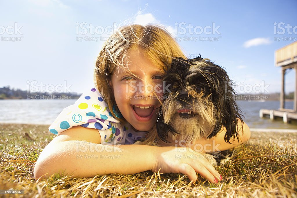 Girl Playing with Dog royalty-free stock photo
