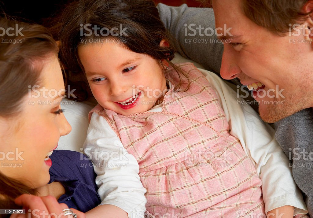 Girl playing with her parents royalty-free stock photo