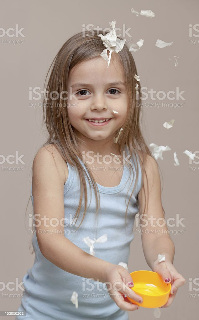 Girl playing with paper stock photo