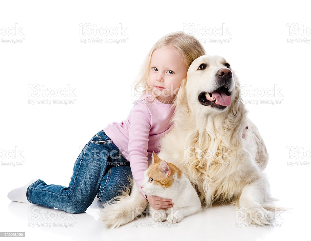 girl playing with pets - dog and cat. stock photo