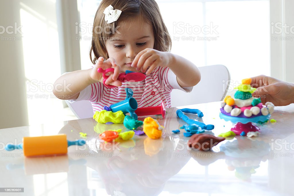 Girl playing with play dough royalty-free stock photo