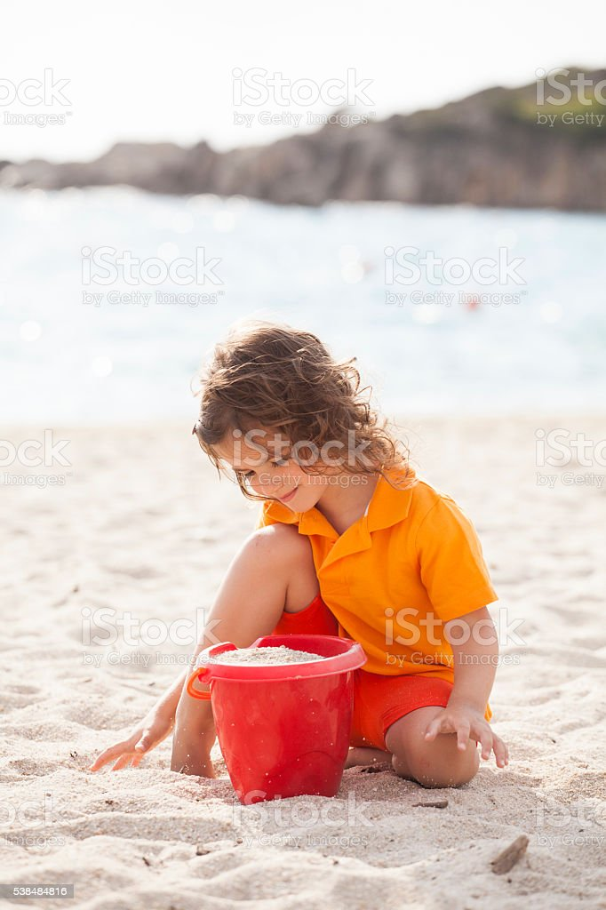 girl playing with sand stock photo