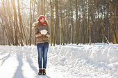 Girl playing with snow in park