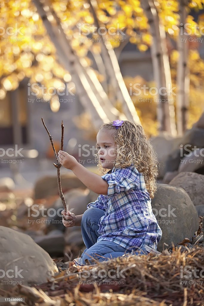 Girl Playing with Stick royalty-free stock photo