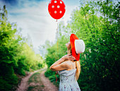 Girl playing with the balloon