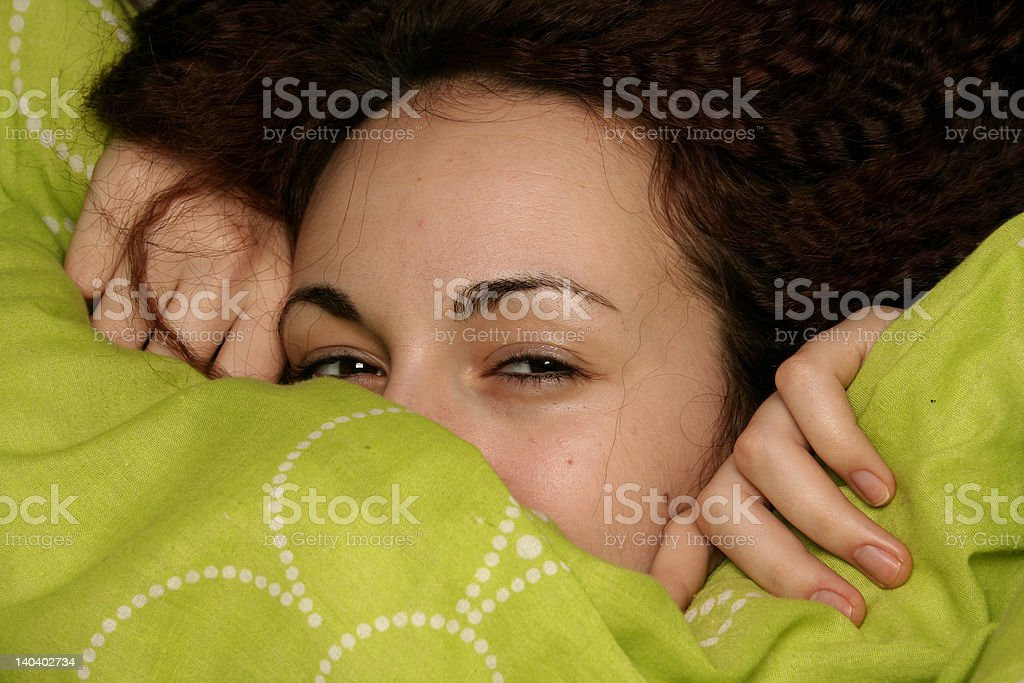 Girl playing with the quilt royalty-free stock photo