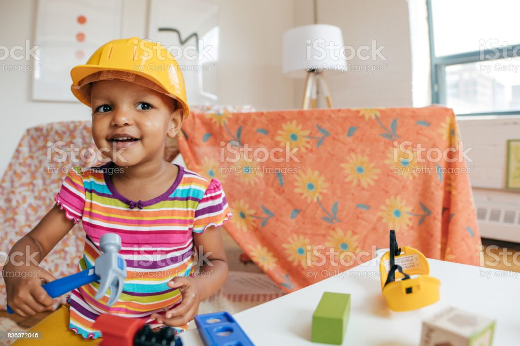 Girl playing with wooden blocks stock photo