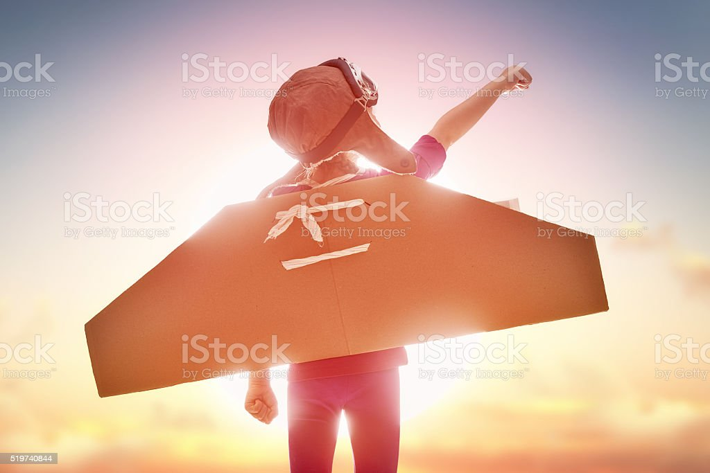 girl plays astronaut stock photo