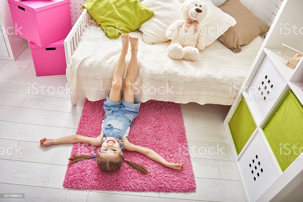 girl plays at home stock photo
