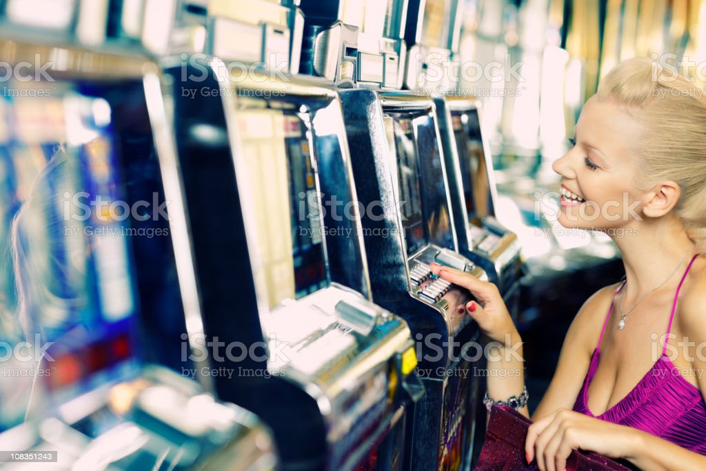 girl plays games in the casino stock photo