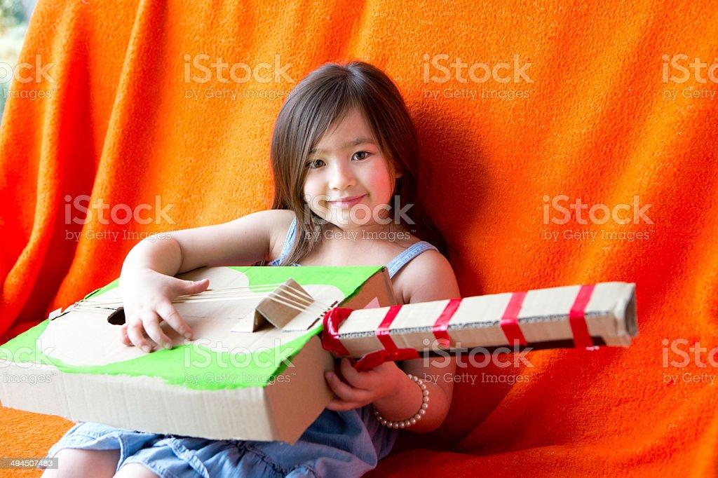 Girl Plays Guitar stock photo