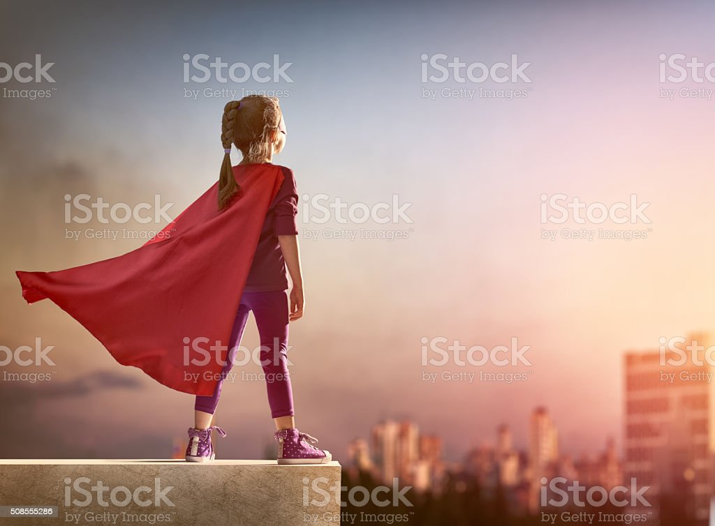 girl plays superhero stock photo