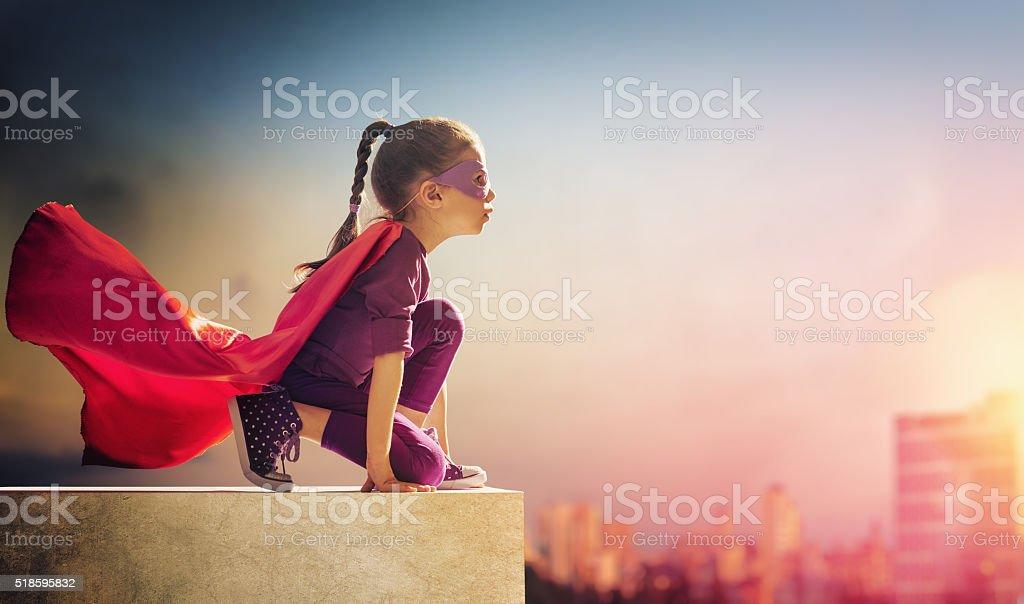 girl plays superhero stock photo