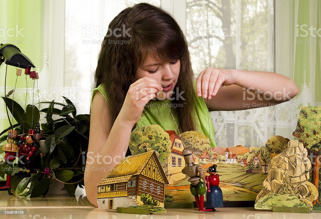 Girl Plays with Puppet stock photo