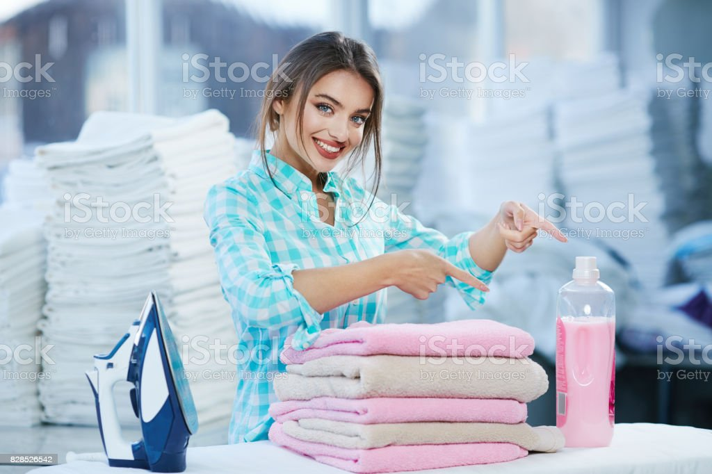 Girl pointing at detergent stock photo