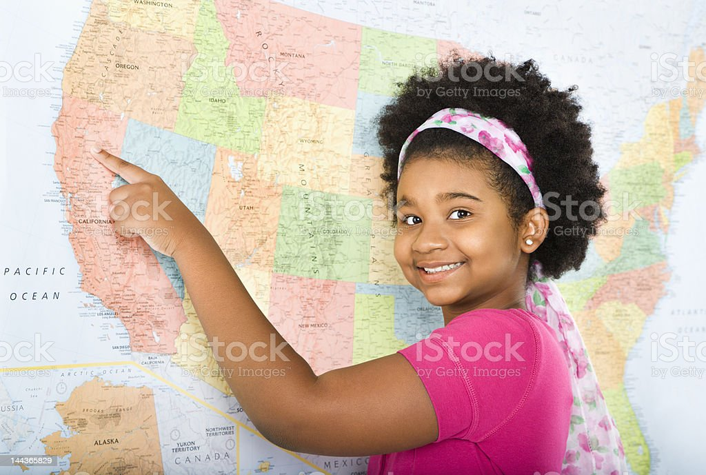 Girl pointing to map. stock photo