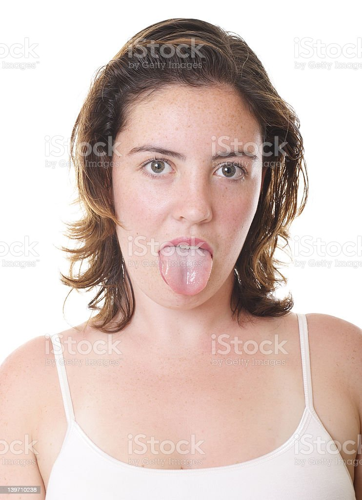 Girl poking tongue stock photo