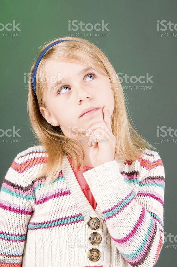 Girl pondering stock photo